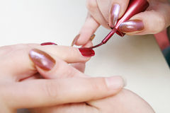 Beautician painting nails Royalty Free Stock Images