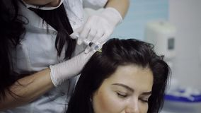 Beautician and the patient in the clinic of aesthetic medicine. The injection. stock video