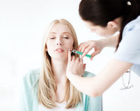 Beautician with patient doing botox injection Stock Images