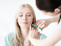 Beautician with patient doing botox injection Royalty Free Stock Photography