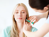 Beautician with patient doing injection Royalty Free Stock Photography