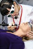 Beautician performs a laser procedure stock images