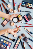 Beautician with powder and lipstick Royalty Free Stock Photo