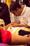 Beautician provide pedicure treatment at beauty expo Stock Images