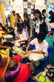 Beautician provide pedicure treatment at beauty expo Stock Image