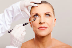 Beautician makeup woman Stock Photo
