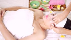 Beautician removing woman beauty mask stock video footage