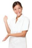 Beautician/terapista di massaggio che mostra sul bianco fotografia stock