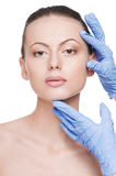 Beautician touch and exam health woman face Stock Photos