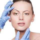 Beautician touch and exam health woman face Royalty Free Stock Photos