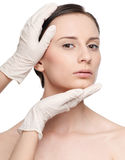 Beautician touch and exam health woman face. Stock Photos