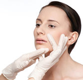 Beautician touch and exam health woman face. Royalty Free Stock Photo