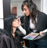 Beautician treats customer Royalty Free Stock Photos