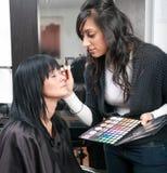 Beautician treats customer royalty free stock photos