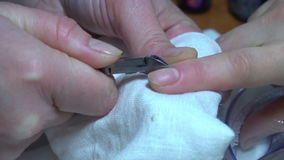 Beautician trimming cuticles of female client. stock footage