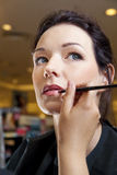 Beautician Using Lip Brush Stock Photo