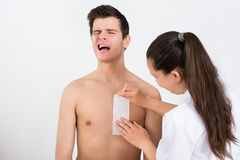 Beautician Waxing Man's Chest In Beauty Center Stock Photo