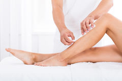 Beautician Waxing Woman`s Leg stock images