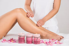 Beautician Waxing Woman& x27;s Leg At Salon Stock Photos