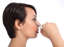 Beautician woman using eye lash curler in make up Royalty Free Stock Photos