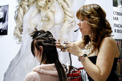 Beauticians doing hair extensions stock photo
