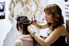 Beauticians doing hair extensions Stock Images