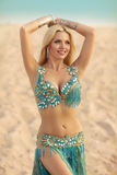 Beautidul smiling lady dancing Belly dance in the sands desert. royalty free stock photography