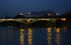 One night along the guadalquivir, Seville, Spain, in the popular neighborhood of Triana. The beauties of modern and classical Spain, with traditions and colors stock photo