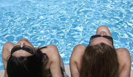 Beauties at poolside Royalty Free Stock Photos