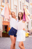 Beauties with shopping bags. Stock Photography