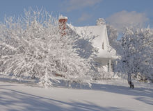 Beauties of winter, country house.   Country house after ice and snow, a real Christmas landscape or the holiday season. Apple tree snowy and whiteness of snow Royalty Free Stock Photos