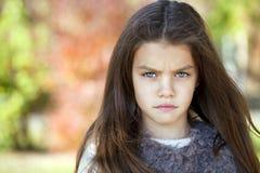 Beautifal little girl in the autumn park Stock Photo