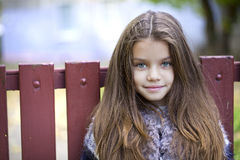Beautifal little girl in the autumn park Stock Images