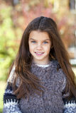 Beautifal little girl in the autumn park Royalty Free Stock Photos