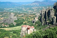 Beautifful view of small rock monastery Roussanou St. Barbarain and Thessalian plain. Meteora, Greece royalty free stock images