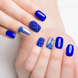 Beautifil blue manicure with rhinestone. Nail Design. Close-up Royalty Free Stock Image