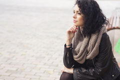 Beautifil brunette caucasian woman in leather jacket and scarf w Stock Photos