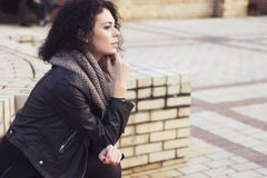 Beautifil brunette caucasian woman in leather jacket and scarf w Stock Photo