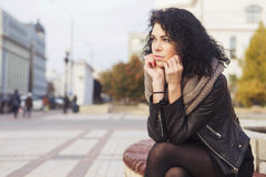 Beautifil brunette caucasian woman in leather jacket and scarf w Stock Image