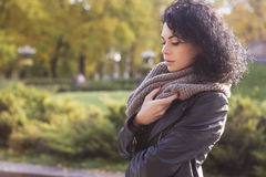 Beautifil brunette caucasian woman in leather jacket and scarf w Royalty Free Stock Photo