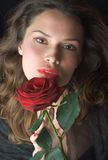 Beautifil lady with red rose. Romantic portrait. Sexy young woman with red rose. Facial portrait Royalty Free Stock Photos