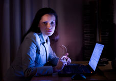 Beautifil lady is surfing the internet late Stock Images