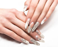 Beautifil wedding manicure for the bride in gentle tones with rhinestone. Nail Design. Close-up royalty free stock images