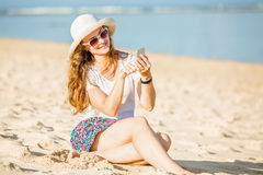 Beautifil young woman on the beach at sunny day Stock Image