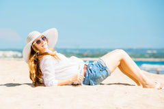 Beautifil young woman lying on the beach at sunny Stock Photo