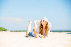 Beautifil young woman lying on the beach at sunny Royalty Free Stock Image