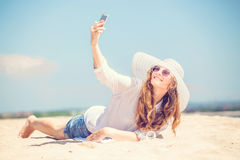 Beautifil young woman lying on the beach at sunny Royalty Free Stock Photography