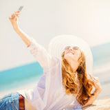 Beautifil young woman lying on the beach at sunny Royalty Free Stock Photos