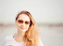 Beautifil young woman walking along the beach at Stock Image