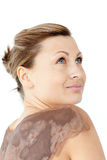 Beautifl woman with mud on her back Stock Images